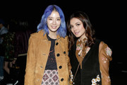Irene Kim (L) and Fazura attend Coach Spring 2018 fashion show during New York Fashion Week at Basketball City - Pier 36 - South Street on September 12, 2017 in New York City.