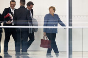 German Chancellor Angela Merkel (R) is followed by CSU general secretary Andreas Scheuer (3rd.L) and CDU politican Jens Spahn (L) during the second phase of coalition negotiations at the Reichstag on November 7, 2017 in Berlin, Germany. For the past few weeks the three parties have wrangled over issues in a preliminary round of negotiations that proved difficult and cumbersome, though German Chancellor Angela Merkel, leader of the CDU, has said she is confident the three parties will succeed in forming a new government soon.