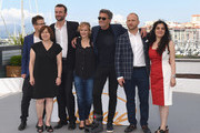 "(L-R from 2nd L) Producer Ewa Puszczynska, actor Tomasz Kot, actress Joanna Kulig, director Pawel Pawlikowsk, actor Borys Szyc and producer Tanya Seghatchian attend the photocall for ""Cold War (Zimna Wojna)"" during the 71st annual Cannes Film Festival at Palais des Festivals on May 11, 2018 in Cannes, France."