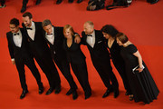 "Actor Tomasz Kot, director Pawel Pawlikowski, actress Joanna Kulig, actor Borys Szyc, producer Tanya Seghatchian, producer Ewa Puszczynska and guest (L) attend the screening of ""Cold War (Zimna Wojna)"" during the 71st annual Cannes Film Festival at Palais des Festivals on May 10, 2018 in Cannes, France."