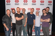(L-R) Clear Channel SVP of Programming Andrew Jeffries, Clear Channel LA Program Director Michael LaCrosse, Will Champion of Coldplay, Clear Channel LA Program Director Mike Kaplan, Chris Martin of Coldplay, Clear Channel SVP of Programming John Ivey, Guy Berryman and Jonny Buckland of Coldplay pose backstage during the Coldplay iHeartRadio Album Release Party at the iHeartRadio Theater Los Angeles on May 16, 2014 in Burbank, California. Streaming Live on Yahoo Screen and Clear Channel stations across the country.