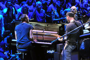 Will Champion, Jonny Buckland and Chris Martin of Coldplay perform live on stage at the Royal Albert Hall on July 1, 2014 in London, England.