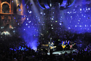 Will Champion, Jonny Buckland, Chris Martin and Guy Berryman of Coldplay perform live on stage at the Royal Albert Hall on July 1, 2014 in London, England.