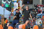 "Guitarist Jonny Buckland (L) and singer Chris Martin of Coldplay perform on NBC's ""Today"" at Rockefeller Plaza on March 14, 2016 in New York City."