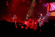 (L-R) Musicians Jonny Buckland, Chris Martin, Guy Berryman, and Will Champion of Coldplay perform onstage at Royce Hall, UCLA on May 19, 2014 in Westwood, California.