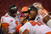 Head coach Dabo Swinney and Clelin Ferrell #99 of the Clemson Tigers celebrates his teams 44-16 win over the Alabama Crimson Tide with the trophy in the CFP National Championship presented by AT&T at Levi's Stadium on January 7, 2019 in Santa Clara, California.