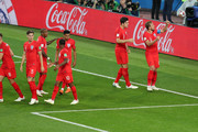 Harry Kane of England celebrates with team mates scoring the opening goal from a penalty during the 2018 FIFA World Cup Russia Round of 16 match between Colombia and England at Spartak Stadium on July 3, 2018 in Moscow, Russia.