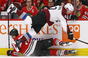 Gabriel Landeskog #92 of the Colorado Avalanche and Connor Murphy #5 of the Chicago Blackhawks get tangled up along the boards at the United Center on March 6, 2018 in Chicago, Illinois.