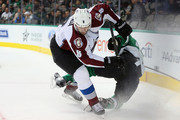 Jan Hejda #8 of the Colorado Avalanche skates the puck past Antoine Roussel #21 of the Dallas Stars in the first period at American Airlines Center on February 27, 2015 in Dallas, Texas.
