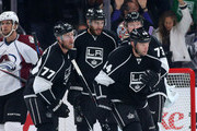 Robyn Regehr #44 of the Los Angeles Kings celebrates with teammates as he skates toward the bench after scoring a first period goal against the Colorado Avalanche at Staples Center on April 4, 2015 in Los Angeles, California.