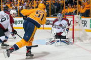 Austin Watson #51 of the Nashville Predators takes a shot wide of goalie Jonathan Bernier #45 of the Colorado Avalanche during the second period in Game Two of the Western Conference First Round during the 2018 NHL Stanley Cup Playoffs at Bridgestone Arena on April 14, 2018 in Nashville, Tennessee.