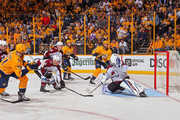 Austin Watson #51 of the Nashville Predators scores a goal against goalie Jonathan Bernier #45 of the Colorado Avalanche during the third period of a 5-4 Predators victory in Game Two of the Western Conference First Round during the 2018 NHL Stanley Cup Playoffs at Bridgestone Arena on April 14, 2018 in Nashville, Tennessee.
