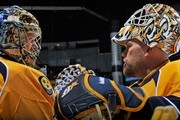 Goalies Pekka Rinne #35 and Chris Mason #30 of the Nashville Predators chat during warm-ups prior to a game against the Colorado Avalanche at the Bridgestone Arena on April 2, 2013 in Nashville, Tennessee.