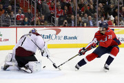 Goalie Semyon Varlamov #1 of the Colorado Avalanche blocks a shot by Alex Chiasson #39 of the Washington Capitals in the second period at Capital One Arena on December 12, 2017 in Washington, DC.