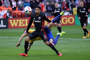 Sean Franklin #5 of D.C. United and Kevin Doyle #9 of Colorado Rapids go after the ball in the first half at RFK Stadium on March 20, 2016 in Washington, DC.