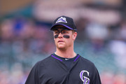 Justin Morneau #33 of the Colorado Rockies looks on during a spring training game against the Arizona Diamondbacks at Salt River Fields at Talking Stick on February 28, 2014 in Scottsdale, Arizona.