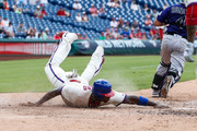Ryan Howard #6 of the Philadelphia Phillies dives home to score a run in the sixth inning of the game against the Colorado Rockies at Citizens Bank Park on August 14, 2016 in Philadelphia, Pennsylvania. The Phillies won 7-6.