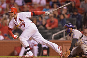 Matt Holliday #7 of the St. Louis Cardinals hits a single in the eighth inning against the Colorado Rockies at Busch Stadium on September 12, 2014 in St. Louis, Missouri. The Cardinals defeated the Rockies 5-1.