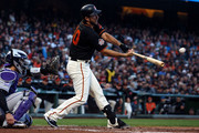 Madison Bumgarner #40 of the San Francisco Giants hits a double against the Colorado Rockies during the third inning at AT&T Park on September 15, 2018 in San Francisco, California. The San Francisco Giants defeated the Colorado Rockies 3-0.