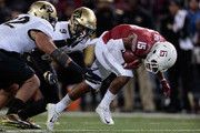 Robert Lewis #15 of the Washington State Cougars carries the ball against Tedric Thompson #9 and John Walker #12 of the Colorado Buffaloes in the first half at Martin Stadium on November 21, 2015 in Pullman, Washington.