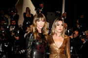 """Image has been digitally altered)  Jennifer Flavin and Sistine Rose Stallone attend the screening of """"Rambo - First Blood"""" during the 72nd annual Cannes Film Festival on May 24, 2019 in Cannes, France."""