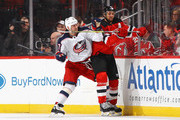 Travis Zajac #19 of the New Jersey Devils is checked by Brandon Dubinsky #17 of the Columbus Blue Jackets during the second period at the Prudential Center on December 8, 2017 in Newark, New Jersey.  (Photo by Bruce Bennett/Getty Images) *** Local Caption *** Brandon Dubinsky; Travis Zajac