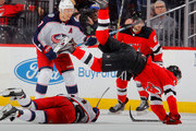 Nico Hischier #13 of the New Jersey Devils flips over Brandon Dubinsky #17 of the Columbus Blue Jackets during the third period on February 20, 2018 at Prudential Center in Newark, New Jersey.