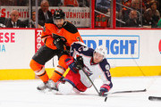 David Clarkson #23 of the Columbus Blue Jackets falls with the puck as Pierre-Edouard Bellemare #78 of the Philadelphia Flyers  defends during their game at the Wells Fargo Center on March 5, 2016 in Philadelphia, Pennsylvania.