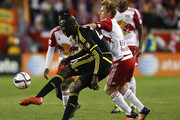 Dax McCarty #11 of New York Red Bulls fights for the ball with Kei Kamara #23 of Columbus Crew during their match at Red Bull Arena on November 29, 2015 in Harrison, New Jersey.