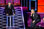 Adam Carolla (L) and Alec Baldwin react onstage during the Comedy Central Roast of Alec Baldwin at Saban Theatre on September 07, 2019 in Beverly Hills, California.