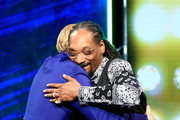 Honoree Justin Bieber (L) and rapper Snoop Dogg hug onstage at The Comedy Central Roast of Justin Bieber at Sony Pictures Studios on March 14, 2015 in Los Angeles, California. The Comedy Central Roast of Justin Bieber will air on March 30, 2015 at 10:00 p.m. ET/PT.