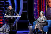Comedian Gilbert Gottfried (L) and roastee Roseanne Barr speak onstage during the Comedy Central Roast of Roseanne Barr at Hollywood Palladium on August 4, 2012 in Hollywood, California.