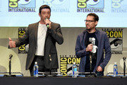 Actor Hugh Jackman (L) and director Bryan Singer speak onstage at the 20th Century FOX panel during Comic-Con International 2015 at the San Diego Convention Center on July 11, 2015 in San Diego, California.