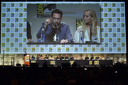 Director Bryan Singer  and actress Jennifer Lawrence (seen on conference-room screen) speak onstage at the 20th Century FOX panel during Comic-Con International 2015 at the San Diego Convention Center on July 11, 2015 in San Diego, California.