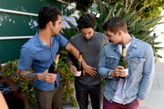 """(L-R) Actors Tyler Posey, Dylan O'Brien, and Cody Christian from """"Teen Wolf"""" celebrate their final season backstage after their Hall H panel during Comic-Con International 2017 at San Diego Convention Center on July 20, 2017 in San Diego, California."""