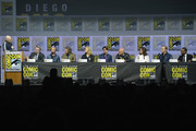 "(L-R) Bill Burr, Vince Gilligan, Aaron Paul, Bryan Cranston, Anna Gunn, RJ Mitte, Dean Norris, Betsy Brandt, Bob Odenkirk, and Giancarlo Esposito speak onstage during the ""Breaking Bad"" 10th Anniversary Celebration during Comic-Con International 2018 at San Diego Convention Center on July 19, 2018 in San Diego, California."