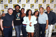(L-R) Krondon, Cress Williams, Christine Adams, Nafessa Williams, China Anne McClain, James Remar, and Damon Gupton attend the 'Black Lightning' Press Line during Comic-Con International 2018 at Hilton Bayfront on July 21, 2018 in San Diego, California.