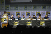 "(L-R) Karan Soni, David Leitch, Paul Wernick, Rhett Reese, Brianna Hildebrand, Stefan Kapicic, Zazie Beetz, and Ryan Reynolds speak onstage at the ""Deadpool 2"" panel during Comic-Con International 2018 at San Diego Convention Center on July 21, 2018 in San Diego, California."
