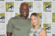 Peter Mensah (L) and Arielle Kebbel attend the 'Midnight Texas' Press Line during Comic-Con International 2018 at Hilton Bayfront on July 21, 2018 in San Diego, California.