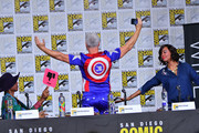 John Barrowman and Aisha Tyler speak onstage at The Great Debate panel hosted by SYFY WIRE during Comic-Con International 2018 at San Diego Convention Center on July 19, 2018 in San Diego, California.