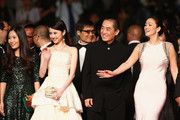 "Zhang Huiwen, Zhang Yimou Gong Li attend the ""Gui Lai"" premiere during the 67th Annual Cannes Film Festival on May 20, 2014 in Cannes, France."
