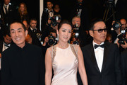 "Zhang Yimou,actress Gong Li and actor Chen Daoming attend the ""Gui Lai"" premiere during the 67th Annual Cannes Film Festival on May 20, 2014 in Cannes, France."