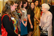 Queen Elizabeth II meets members of the Commonwealth Secretariat at the Commonwealth Reception at Marlborough House on March 10, 2014 in London, England.