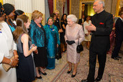 Queen Elizabeth II and Commonwealth Secretary General Kamalesh Sharma greet guests at the Commonwealth Reception at Marlborough House on March 10, 2014 in London, England.