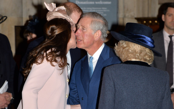 Catherine, Duchess of Cambridge greets Prince Charles, Prince of Wales as they attend the Observance for Commonwealth Day Service At Westminster Abbey on March 9, 2015 in London, England.