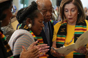 """U.S. Speaker of the House Rep. Nancy Pelosi (D-CA) shares a moment with Rep. John Lewis (D-GA) and Rep. Sheila Jackson-Lee (D-TX) prior to an event at the Emancipation Hall of the U.S. Capitol September 10, 2019 in Washington, DC. The Congressional Black Caucus (CBC) held a ceremony to commemorate """"the 400th anniversary of the first-recorded forced arrival of enslaved African people."""""""
