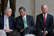 (L-R)  Senate Majority Leader Harry Reid (D-NV), Speaker of the House John Boehner (R-OH), and U.S. Vice President Joe Biden are seen during a dedication ceremony for the new Frederick Douglass Statue in Emancipation Hall in the Capitol Visitor Center, at the U.S. Capitol, on June 19, 2013 in Washington, DC. The 7 foot bronze statue of Douglass joins fellow black Americans Rosa Parks, Martin Luther King Jr. and Sojourner Truth on permanent display in the Capitol's Emancipation Hall.