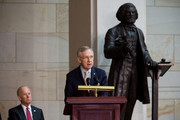 U.S. Vice President Joe Biden looks on, as Senate Majority Leader Harry Reid (D-NV) delivers remarks during a dedication ceremony for the new Frederick Douglass Statue in Emancipation Hall in the Capitol Visitor Center, at the U.S. Capitol, on June 19, 2013 in Washington, DC. The 7 foot bronze statue of Douglass joins fellow black Americans Rosa Parks, Martin Luther King Jr. and Sojourner Truth on permanent display in the Capitol's Emancipation Hall.