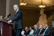 U.S. Vice President Joe Biden delivers remarks during a dedication ceremony for the new Frederick Douglass Statue in Emancipation Hall, as (L-R) Sen. Chuck Schumer (D-NY), House Minority Leader Nancy Pelosi (D-CA),  Senate Minority Leader Mitch McConnell (R-KY), Senate Majority Leader Harry Reid (D-NV), Speaker of the House John Boehner (R-OH) look on in the Capitol Visitor Center, at the U.S. Capitol, on June 19, 2013 in Washington, DC. The 7 foot bronze statue of Douglass joins fellow black Americans Rosa Parks, Martin Luther King Jr. and Sojourner Truth on permanent display in the Capitol's Emancipation Hall.