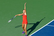 Bojana Jovanovski of Serbia serves the ball to Eugenie Bouchard of Canada during the Connecticut Open at the Connecticut Tennis Center at Yale on August 18, 2014 in New Haven, Connecticut.